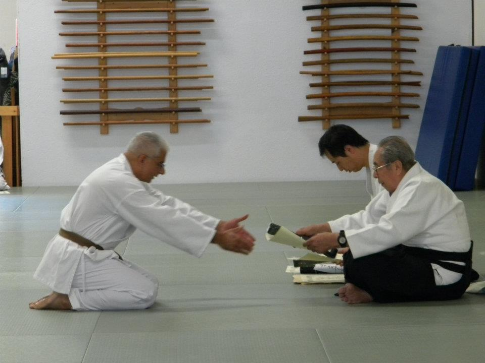 Dr. Aiki (Jaideep Sensei) receiving Shodan certificate (black belt) in the art of Roppokai from Soshi Okamoto